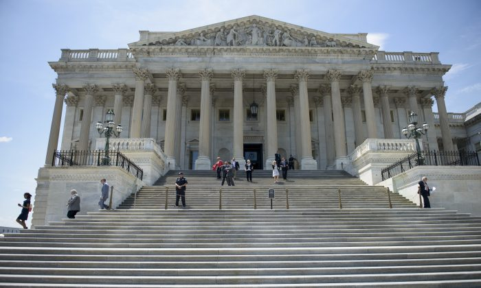 Members of Congress leave after a series of votes effecting the fast tracking of the Trans-Pacific Partnership on Capitol Hill, in Washington, D.C., on June 12, 2015. (Brendan Smialowski/AFP/Getty Images)
