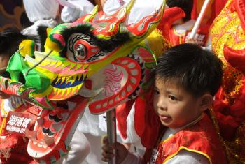 This boy is holding a dragon, an auspicious animal in the Chinese tradition, during an early Chinese New Year performance at a shopping mall in Hong Kong. (Mike Clarke/AFP/Getty Images)