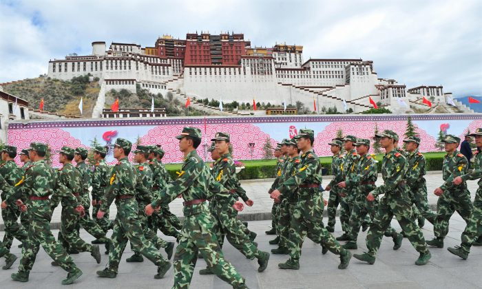 Chinese paramilitary policemen patrol in front of the Potala Palace during the ceremony for the 2008 Beijing Olympic Games torch relay in Lhasa on June 21, 2008. (TEH ENG KOON/AFP/Getty Images)