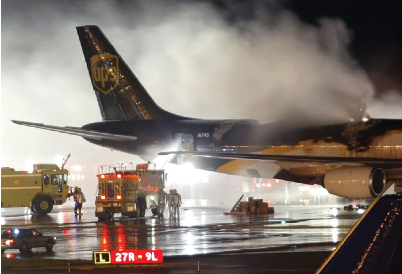 An emergency crew arrives on the scene where a UPS 747-400 Boeing cargo plane caught fire due to lithium ion batteries in Dubai on Sept. 5, 2010. (Courtesy of National Safety Transport Board)