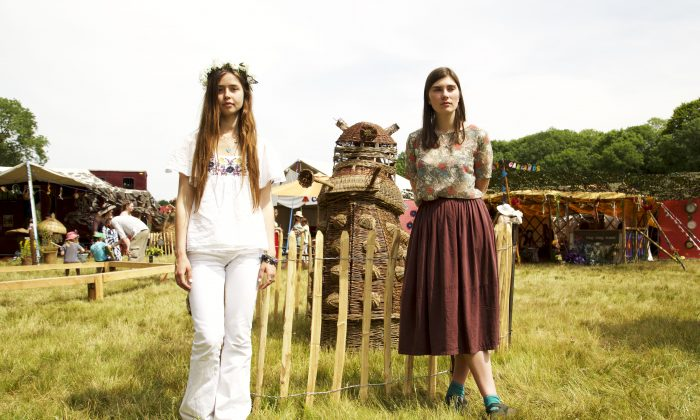 (L-R) Musicians Flo Morrisey and Floella Grace hang out together with a wicker dalek at Blissfields time themed festival