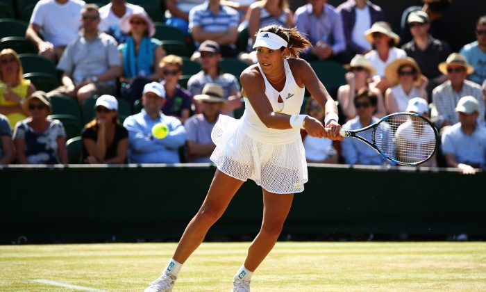Garbine Muguruza of Spain returns a shot in her Ladies' Singles Fourth Round match against Caroline Wozniacki of Denmark during day seven of the Wimbledon Lawn Tennis Championships at the All England Lawn Tennis and Croquet Club on July 6, 2015 in London, England. (Ian Walton/Getty Images)