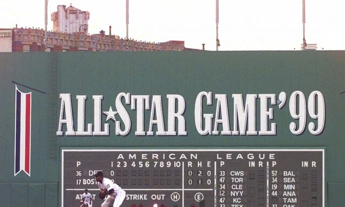 "Fenway Park's famed left field wall, ""The Green Monster,"" decorated for the 1999 All-Star game upcoming in July, looms behind Red Sox second baseman Jose Offerman during the second inning against the Detroit Tigers in Boston Tuesday night, June 1, 1999. (AP Photo/Elise Amendola)"