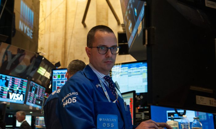 A trader works on the floor of the New York Stock Exchange in the afternoon on June 29, 2015 in New York City. Despite statements to the contrary, the cybersecurity community is not ruling out the possibility of a cyberattack. (Bryan Thomas/Getty Images)