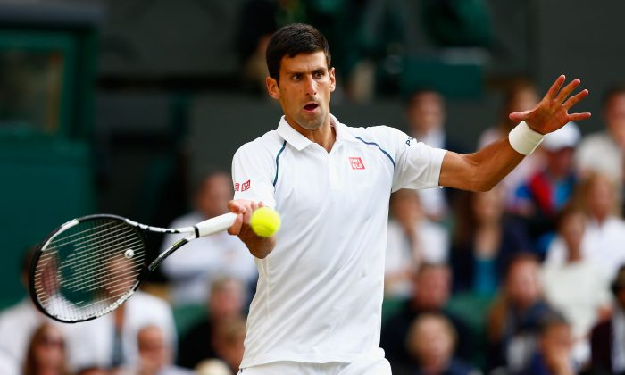 Novak Djokovic of Serbia plays a forehand in his Gentlemens Singles Quarter Final match against Marin Cilic of Croatia during day nine of the Wimbledon Lawn Tennis Championships at the All England Lawn Tennis and Croquet Club on July 8, 2015 in London, England. (Julian Finney/Getty Images)
