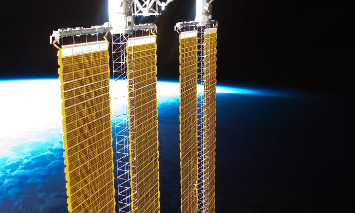 Solar panels on the International Space Station. China wants to build space solar collectors many times larger that would send energy back to the ground by laser or microwave (NASA).