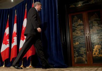 BEIJING, CHINA - Prime Minister Stephen Harper concludes a news conference Wednesday after delivering an update on Canada's Economic Action Plan. (Jason Ransom / Prime Minister's Office)