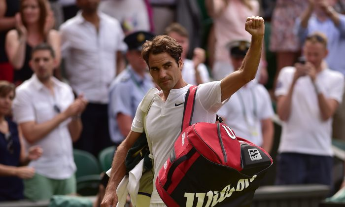 Switzerland's Roger Federer waves to the crowd as he leaves the court after beating Britain's Andy Murray during their men's semi-final match on day eleven of the 2015 Wimbledon Championships at The All England Tennis Club in Wimbledon, southwest London, on July 10, 2015. Federer won the match 7-5, 7-5, 6-4. (Leon Neal/AFP/Getty Images)