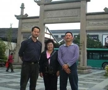 Liao Shuangyuan (R), a democracy activist from Guizhou Province, with his wife Wu Yuqin, and Lai Jinbiao. Liao was taken away by police after arranging a meeting with Lai and has not been heard from since. (The Epoch Times Photo Archive)