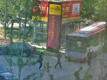 Police cars and bus are parked near Shouwang Church worship site in Beijing, ready to take church members away, April 24. (Photo provided by an anonymous insider)