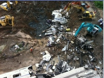Crews Bury Wreckage after Wenzhou Train Collision.  (Posted to Weibo.com)
