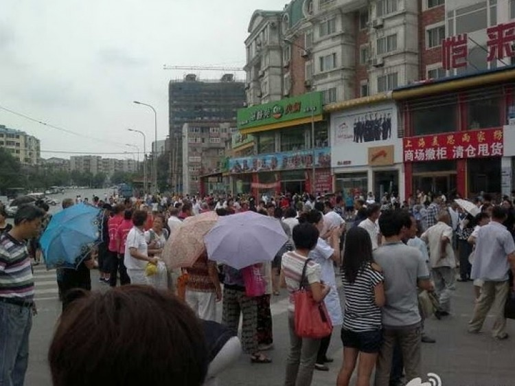 Dalian Residents March Against Toxic 'Snow'