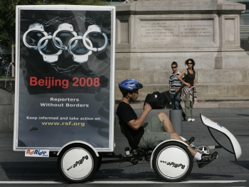 Bikers with mobile billboards from the Reporters Without Borders group launch an international campaign in New York 07 August 2007 on the 2008 Summer Olympic Games in Beijing. (Timothy A. Clary/AFP/Getty Images)