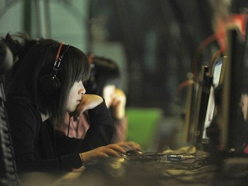 People at an internet cafe in Beijing. China on May 12. (Gou Yige/Getty Images)
