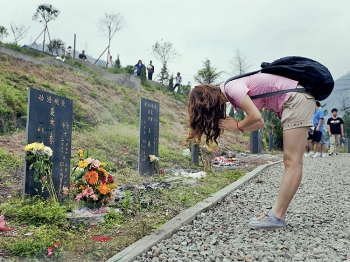 People mourn for fellow countrymen lost in the 2008 Sichuan earthquake on the third anniversary on May 12, 2011 in Wenchuan, Sichuan Province of China. The earthquake hit on May 12, 2008 and killed at least 68,000 people.   (ChinaFotoPress/Getty Images)