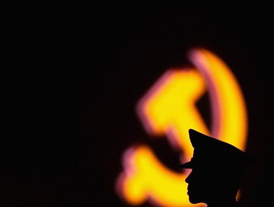 A paramilitary policeman guards in front of an emblem of the Chinese Communist Party at Tiananmen Square on June 28, 2011 in Beijing, China (Feng Li/Getty Images)