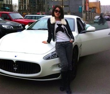A picture of 'Guo Meimei Baby', as she calls herself, posing in front of one of her many cars. Meimei claimed to be the general manager of a firm called 'Red Cross Commerce,' as she flaunted her wealth online. It sparked a huge controversy and stoked widespread public suspicion over how donations are used. (AFP/Getty Images)