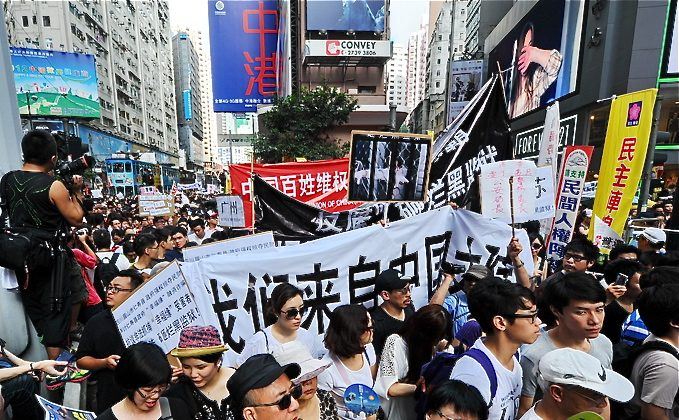 A protest march earlier this month when Chinese regime leader Hu Jintao was visiting Hong Kong. According to Hong Kong law, mainland Chinese police can only investigate people in the city with the assistance from Hong Kong police. (The Epoch Times)