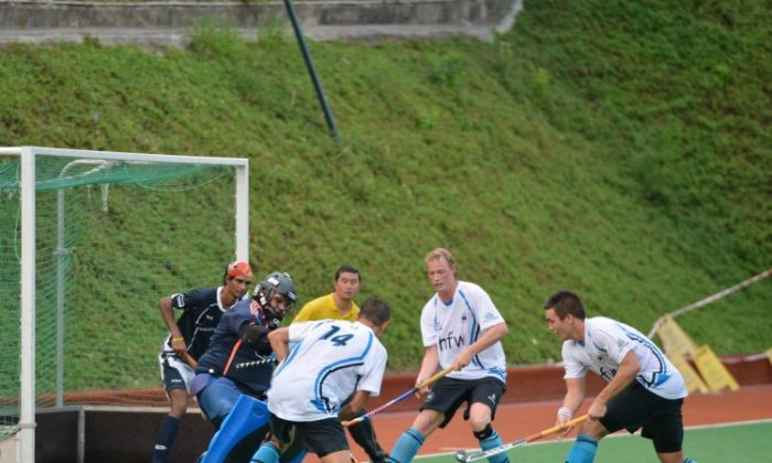 Punjab-A's Goalkeeper was unable to stop this HKFC-A attack as they sealed the game in the dying minute with their fourth goal to Punjab-A's two in the HKHA Men's Premier Division on Sunday Sept. 23. (Bill Cox/The Epoch Times)