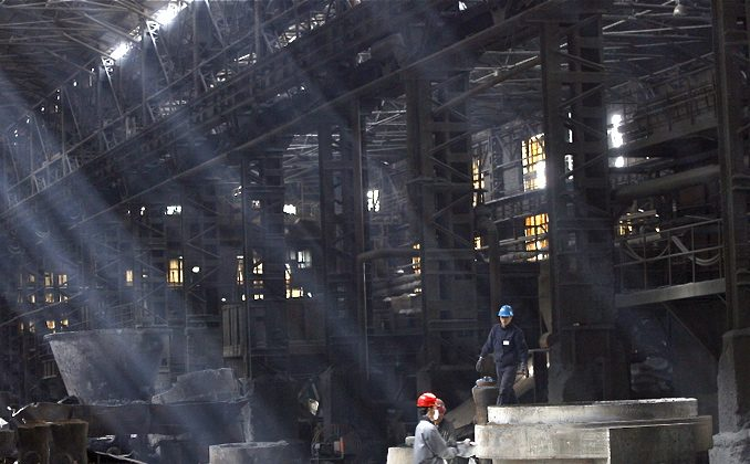 Workers at a iron and steel mill in Shenyang, northeastern China's Liaoning Province, in 2007. Masses of iron ore mines have shut down in China recently and steel prices are in freefall, indicating a potentially harsh reckoning for the economy. (AFP/Getty Images)