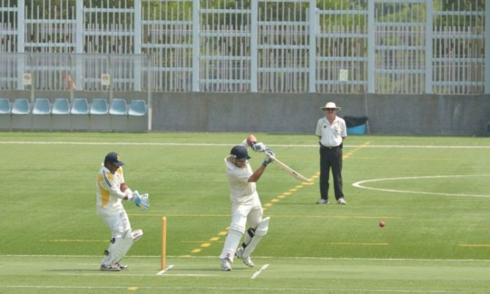 KCC Templars' batsmen starting off their innings run spree of 307 for 8 wickets in the Sunday Championship League match against SLCC at the PKVR Sports Ground, Hong Kong on Sunday Oct 7. Templars won the match by 126 runs in the 50 overs contest. (Bill Cox/The Epoch Times)