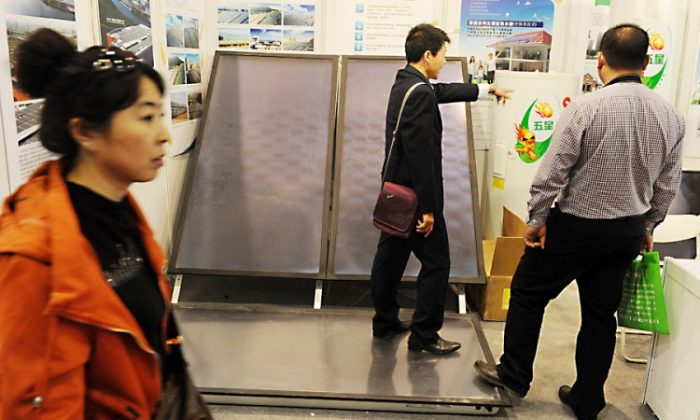 Solar panels are displayed at a trade exhibition in Beijing, Oct. 20. SolarWorld Industries America Inc. announced on Oct. 19 it was filing a formal complaint with Washington against Beijing's illegal dumping into the American market. (Mark Ralston/AFP/Getty Images)