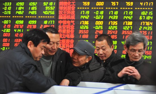 Chinese stock investors at a securities firm in Fuyang, in China's Anhui province, on Jan. 7, 2015 (STR/AFP/Getty Images)