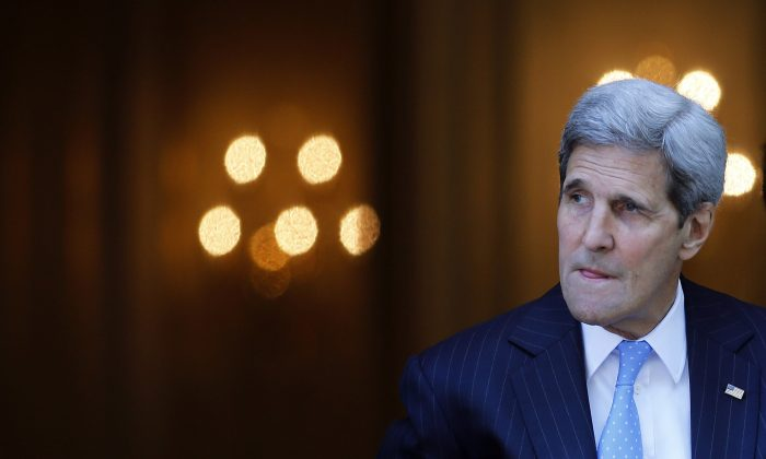 U.S. Secretary of State John Kerry leaves his hotel on the way to mass at the St. Stephen's Cathedral in Vienna, Austria, where the Iran nuclear talks meetings are being held, on July 12, 2015. (Carlos Barria/AFP/Getty Images)