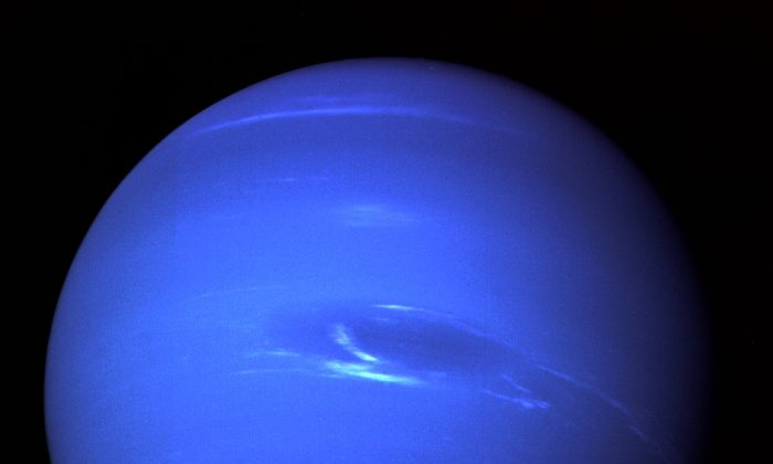 Neptune's Great Dark Spot and its companion bright smudge as captured by Voyager 2. (NASA)