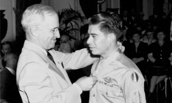 President Harry Truman awards the Congressional Medal of Honor to Mercario Garcia in 1945. (National Archives and Records Administration)