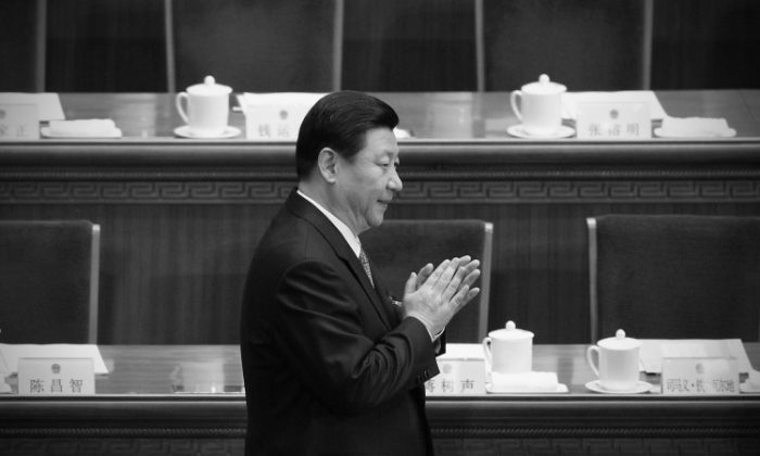 Vice chairman and next annointed communist leader Xi Jinping at a political meeting in Beijing in March. Xi missed several important engagements with foreign officials recently, and netizens have come up with a variety of colorful explanations as to why. (Feng Li/Getty Images)