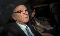 Murdoch Steps Down From Boards of UK Papers