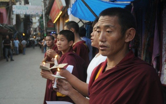 Exiled Tibetans monks chant prayers during a rally to stand in solidarity with monks who self-immolated. In a recent incident, a Tibetan monk protesting in southwestern China was beaten badly by police before being taken away. (STRDEL/AFP/GettyImages)