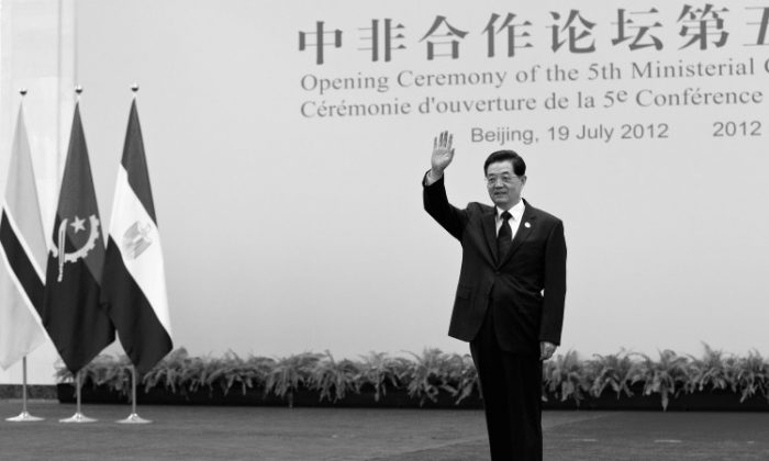 Chinese Communist Party head Hu Jintao waves, standing in the Great Hall of the People July 19 in Beijing, China. Hu is rumored to be giving up all of his Party posts at the 18th Party Congress this October. (Andy Wong/Getty Images)