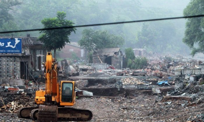 This photo taken on July 26, 2012, shows the damaged homes in the worst-hit area of Fangshan, on Beijing's mountainous southwestern outskirts. Distraught residents reported cars being swept away and said many people were still missing. (STR/AFP/Getty Images)