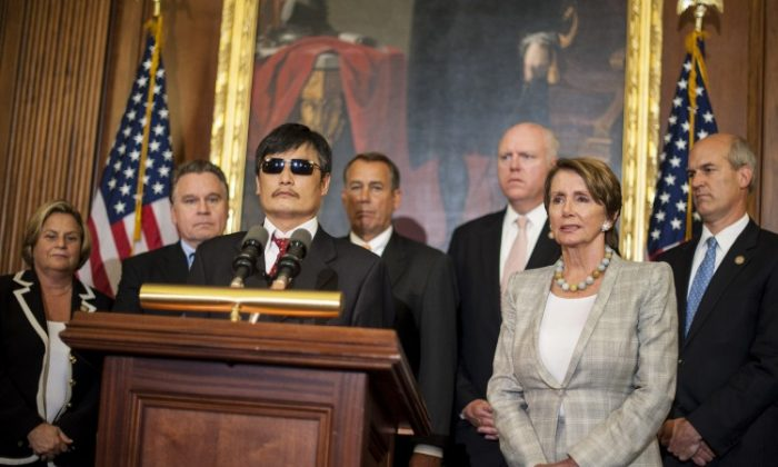 Chinese human rights activist Chen Guangcheng speaks to the press in Washington, D.C., after meeting with Speaker of the House John Boehner and House Minority Leader Nancy Pelosi. (Pete Marovich/Getty Images)