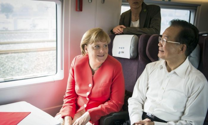 German Chancellor Angela Merkel (L) and Chinese Prime Minister Wen Jiabao travel on a high-speed train from Beijing to Tianjin on Aug. 31, during her two-day visit to China. Merkel was criticized by human rights organizations for focusing almost entirely on trade and economic links. (Guido Bergmann/Bundesregierung-Pool via Getty Images)