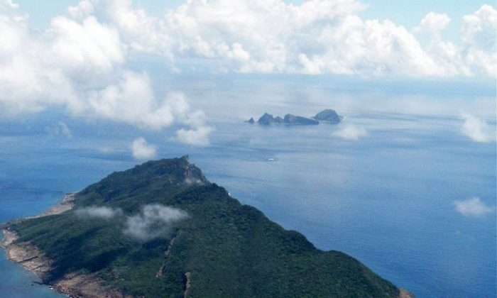 This aerial shot taken on Sept.15, 2010 shows the disputed islands known as Senkaku in Japan and Diaoyu in China. Subtle shifts have taken place between China and Japan in the dispute over rocky islands in the sea recently, though disputes continue to rage. (Jiji Press/AFP/Getty Images)