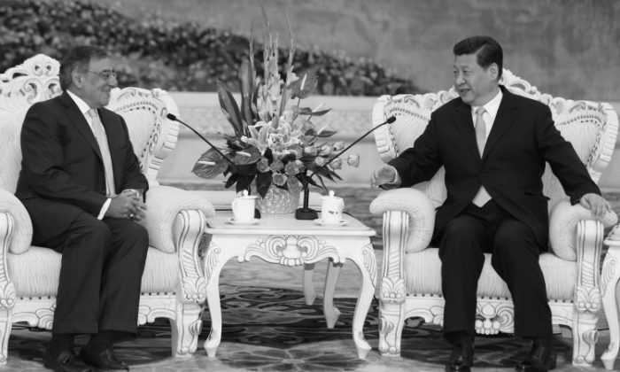 U.S. Secretary of Defense Leon Panetta sits with China's next communist leader Xi Jinping in Beijing on Sept. 19, 2012. It was Xi's first major public appearance in over two weeks, and came amidst claims that Hu Jintao, the current leader, would remain on the Party's military commission for some time after Xi assumes office as head of Party. (Larry Downing/Getty Images)