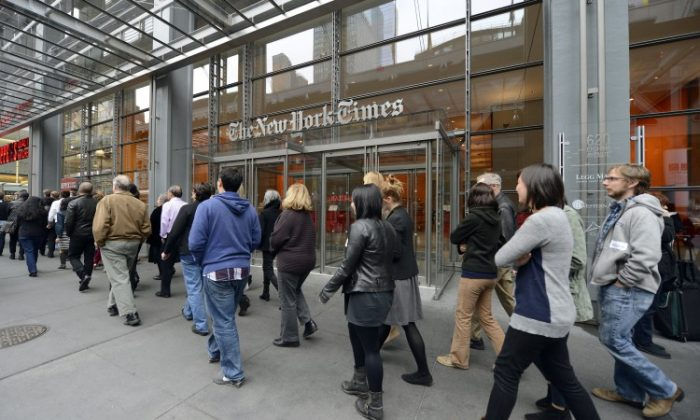 Staffers at the New York Times hold an organized protest outside the New York Times Building in New York on Oct. 8, 2012. (Timothy A. Clary/AFP/GettyImages)