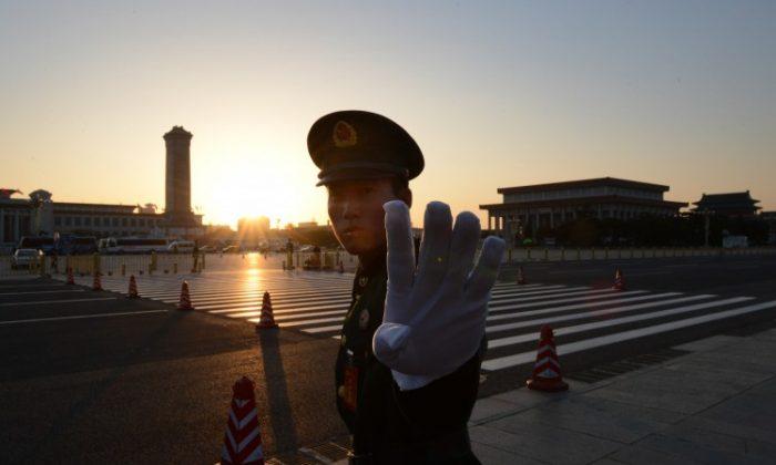 A Chinese policeman outside the Great Hall of the People in Beijing on Nov. 8, 2012. (Mark Ralston/AFP/Getty Images)