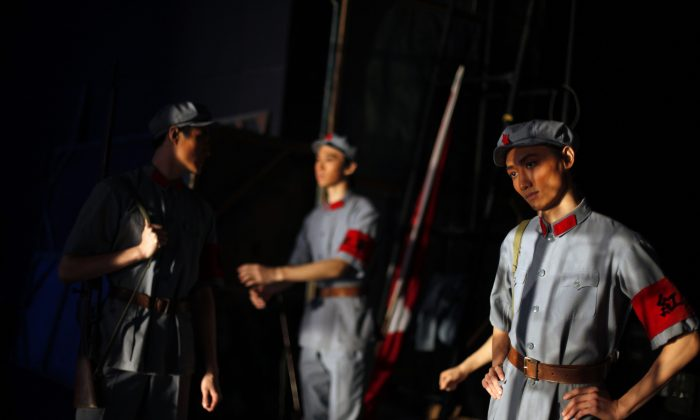 """Dancers from National Ballet of China wait backstage for their turn to perform the Mao-era ballet  """"The Red Detachment of Women"""" in Beijing, China, Wednesday, Dec. 16, 2009. (AP Photo/Elizabeth Dalziel)"""