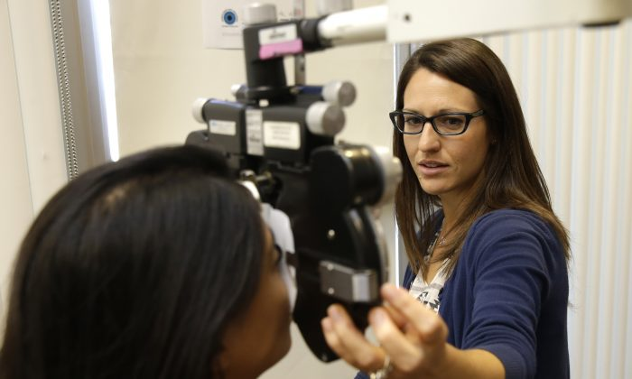 In this photo taken Oct. 6, 2014,  in  World Sight Day, Vision Service Plan,  the nations largest vision care company  hosted a week long program of free eye exams and brand-new glasses at its mobile clinics and at the VSP headquarters in Rancho Cordova, Calif. (AP Photo/Rich Pedroncelli)