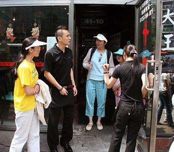 Lucky Joy restaurant staff force Ms. Sun and her friends to leave.  (Evan Mantyk/The Epoch Times)