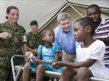 Prime Minister Stephen Harper travelled to Haiti on Feb. 15 and 16, 2010, to assess the humanitarian situation on the ground and discuss the process of rebuilding the country. Approximately 100,000 Canadians have roots in Haiti. (Courtesy of the Prime Minister's Office)