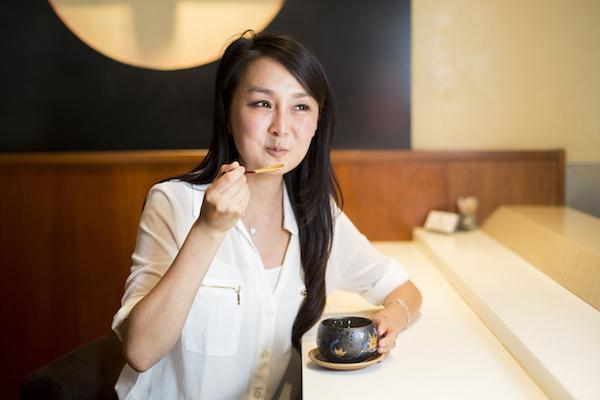 Cici Li tries the Chawanmushi at Sushi Zen . (Samira Bouaou/Epoch Times)