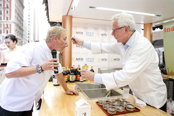 David Bouley (R) gives Terry French a taste of  his Black Truffle  Chanterelle Mushroom Flan. (Samira Bouaou/Epoch Times)