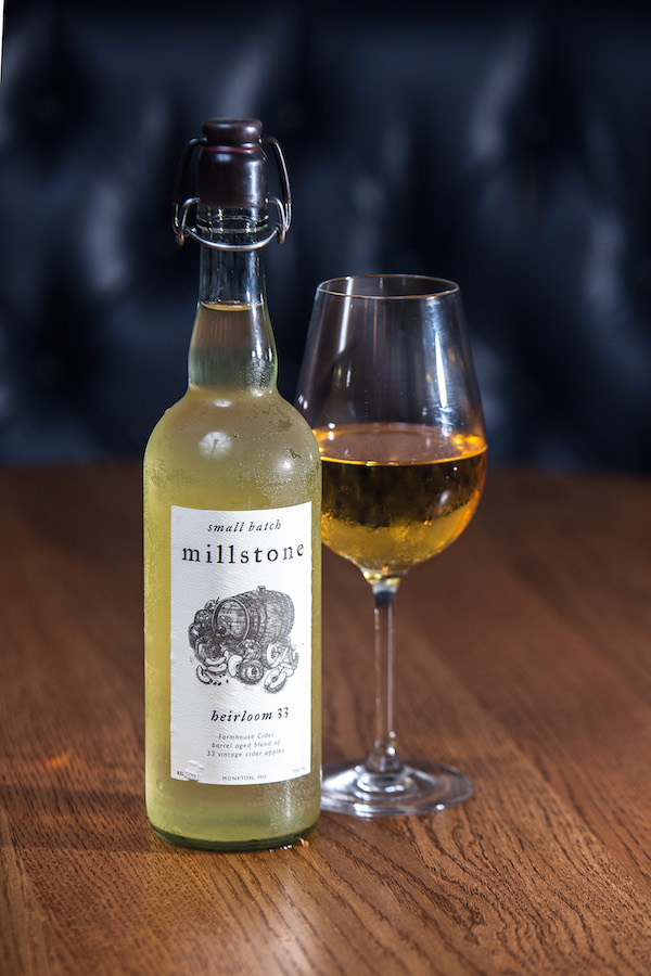 Millstone apple cider bottle and a glass of apple cider at Wassail restaurant. (Petr Svab/Epoch Times)