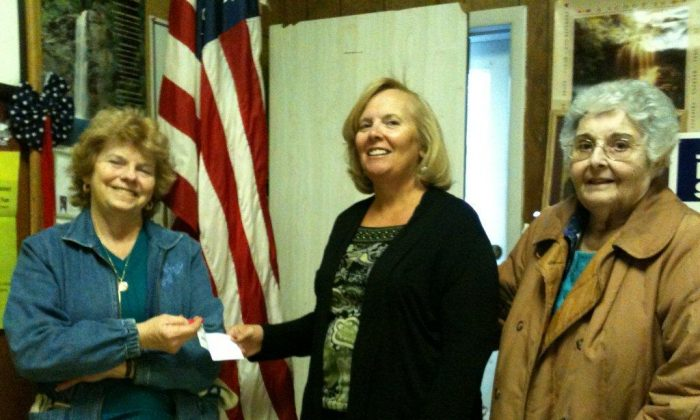 President of the Mamakating Lioness club Joann MacKinnon (L) and Rosalie Frasca (R) present a check to Debbie Call of the Mountain View Methodist Church in Bloomingburg, N.Y. for their food pantry. (Marcia Hamill)