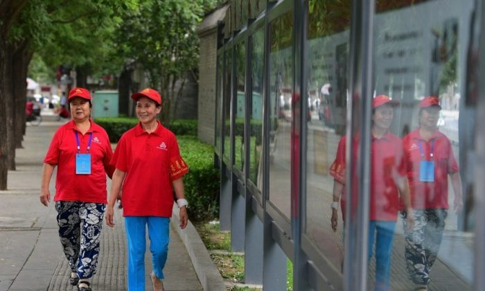 In this undated photo,  Chinese urban block monitors take a stroll in Beijing. (Screenshot via Weibo)